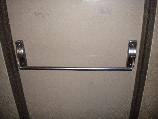 This a well designed push handle door. Just by looking at it you know which side to push on and how it opens. There is no reason for anyone to get confused ... & Ergonomic Design - Push Sign on a Pull Door