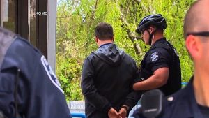 Protesters arrested for demonstrating at 14 Chase banks in Seattle (Credit: Democracy Now!).
