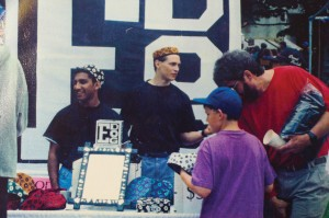 A young Eben Greene selling E-Dog merchandise