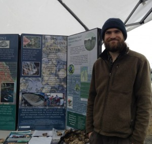 Derek King '14 representing Puget Sound Restoration Fund at an Olympia festival