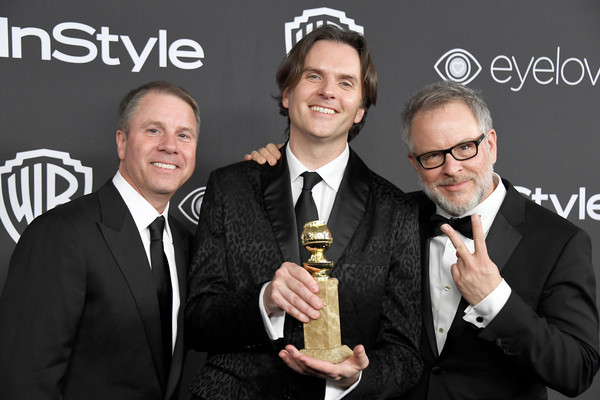 Byron Howard '90 (center) accepts Golden Globe for Best Animated Feature with producer Clark Spencer (left) and Co-Director Rich Moore (right)