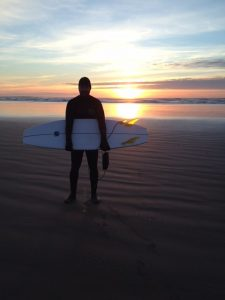 Gaelen Fechner enjoying the sunset after a long day of surfing.