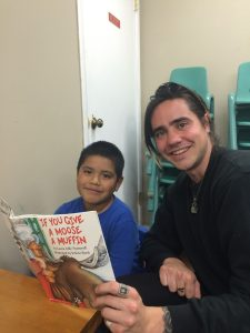 Sean helping a student work on his reading skills.