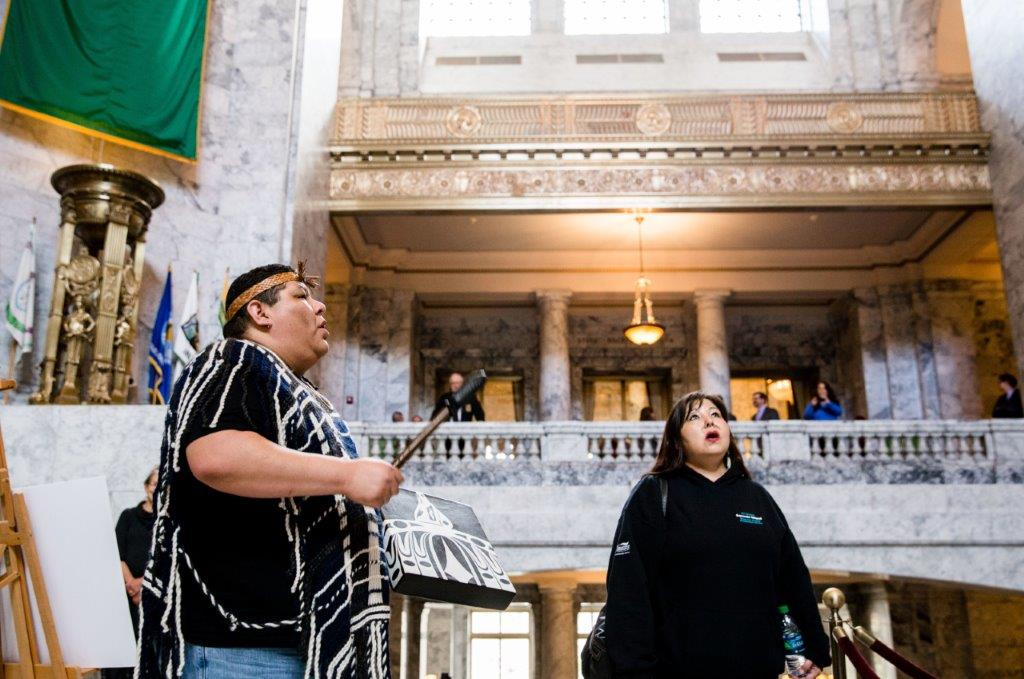 Members of the Salish Tribe fill The Capitol dome with song