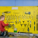 A young boy familiarizes himself with the tools at the bike shop on Tuesday. He and his dad stopped by to get his bike in working order for family trail rides. -- Shauna Bittle photo