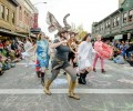 "Students and faculty of the program Awakening the Dreamer, Pursuing the Dream dance through the streets of downtown Olympia during Procession of the Species on Saturday, Apr. 27, 2013. The group dressed as their spirit animals, and represented the element ""air"". -- Shauna Bittle photo"