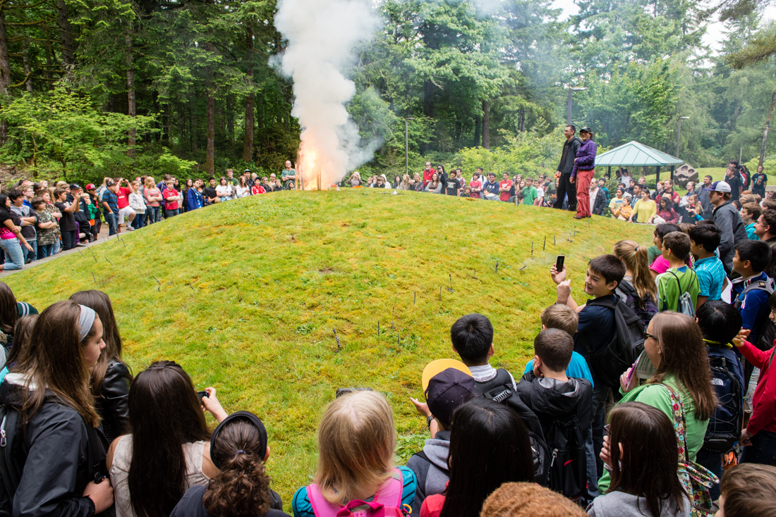 Scads of children from visiting school groups surround the green area outside the Lab buildings for a demonstration of homemade pyrotechnics. Exhibitors lit smoke bombs and a rocket before the finale of a sparkler mandala set in a bicycle wheel. -- Andrew Jeffers photo