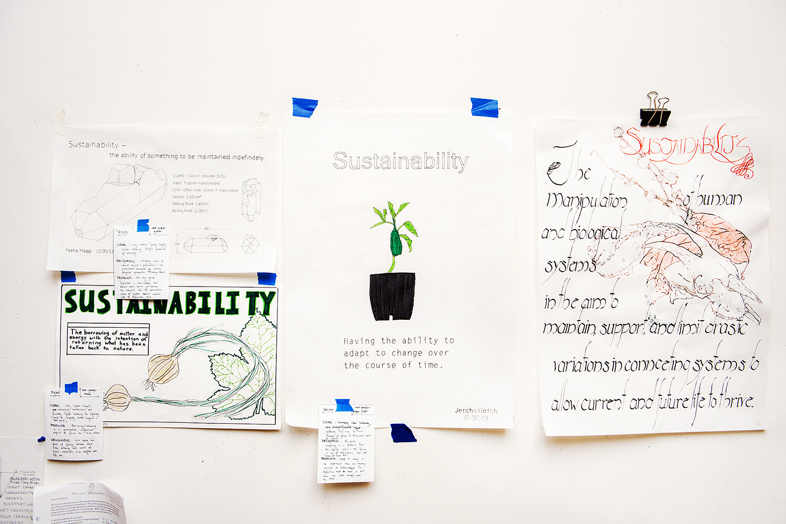 "Students display their understanding of the key word ""Sustainability"" in posters hung around the program studio. -- Shauna Bittle photo"