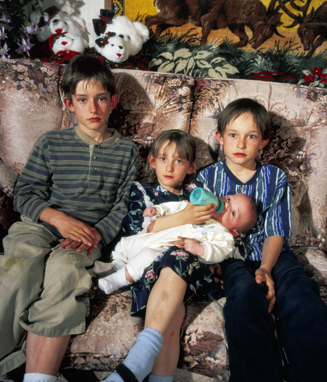 Peggy McDowell was six months pregnant when she suffered a massive cerebral aneurysm and was declared brain dead. She was kept on life support for two months until the birth of her son by cesarean section. The baby (shown with brothers Eddie and Charlie and sister Laura) was named Joshua Moses because his family believed he was a miracle baby. Photo copyright - Robbie McClaran