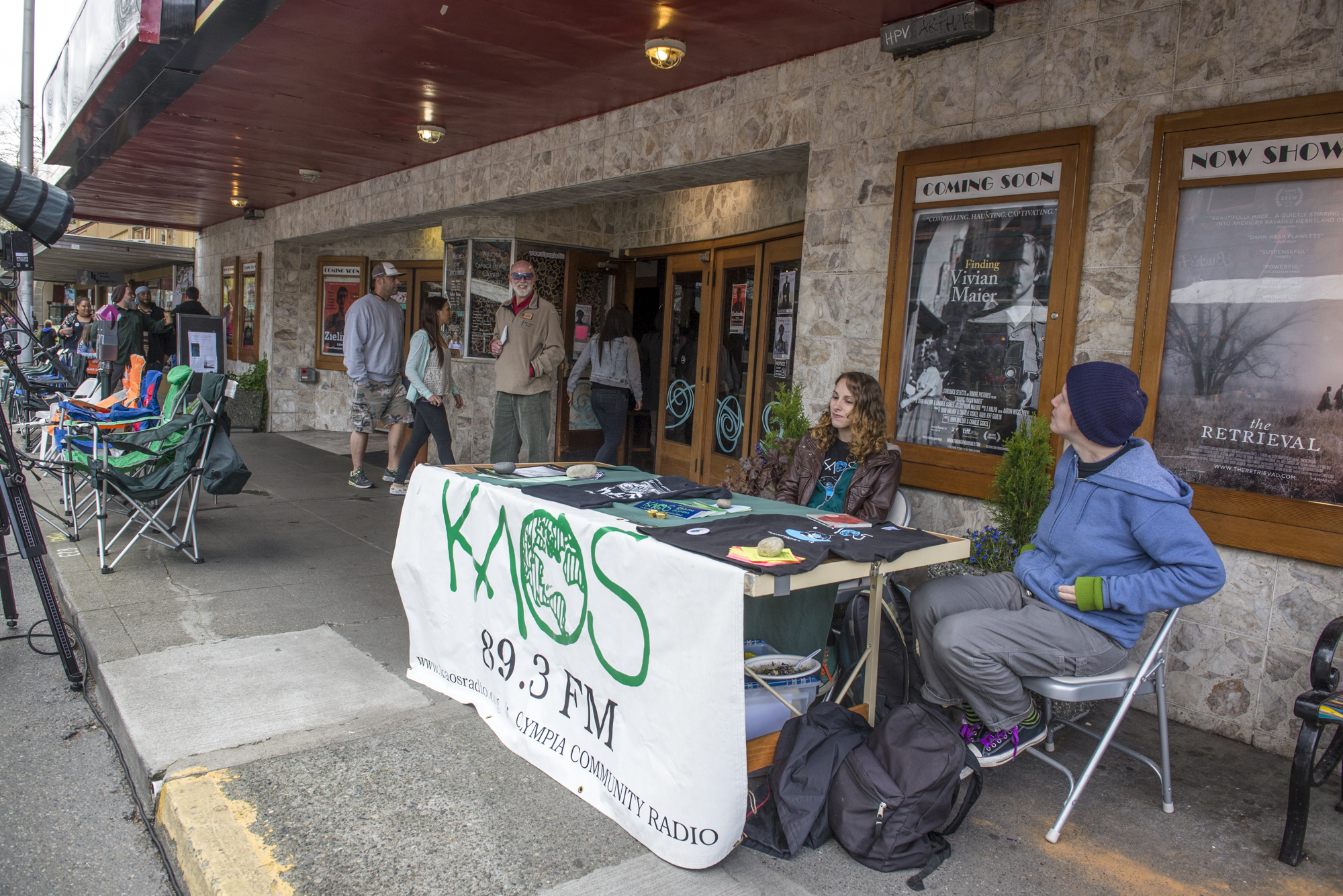 KAOS sets up an info booth outside of the Capitol Theater as the Olympia community members gather in Downtown Olympia for the 2014 Arts Walk. -- Dani Winder photo