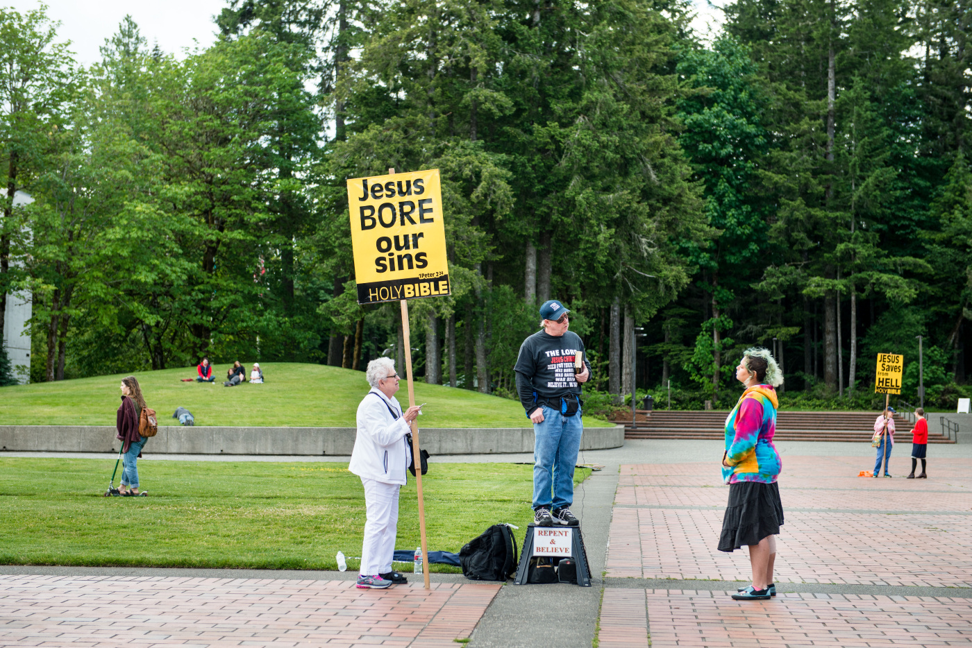 Students interact with religious demonstrators on campus, Wednesday
