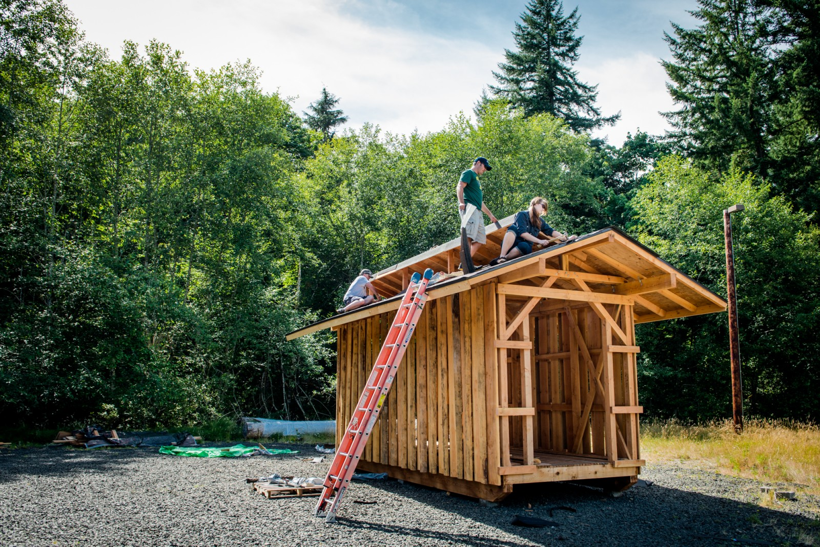Students from the 2013-14 program Green Materials volunteer to build a drying shed designed by the class.