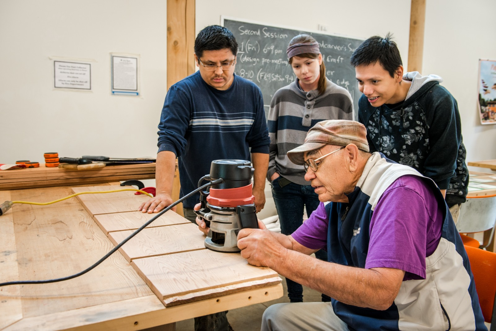 Skkokomish master carver Peter Peterson leads a workshop on making bentwood boxes in the Carving Studio.