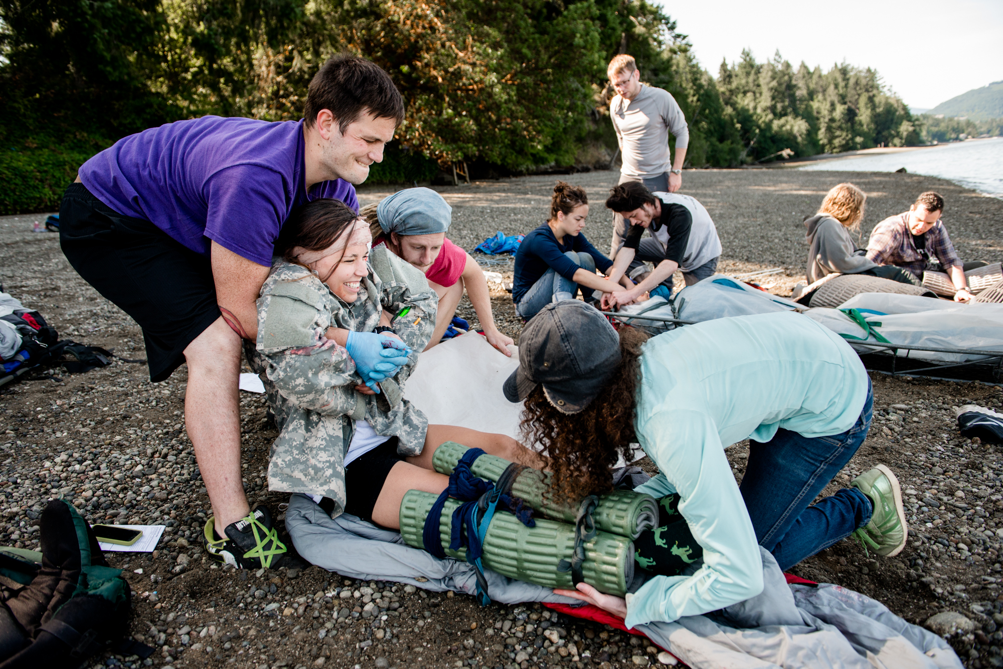 A team of responders prepare to do a princess carry for a student with a simulated leg injury. -- Shauna Bittle photo