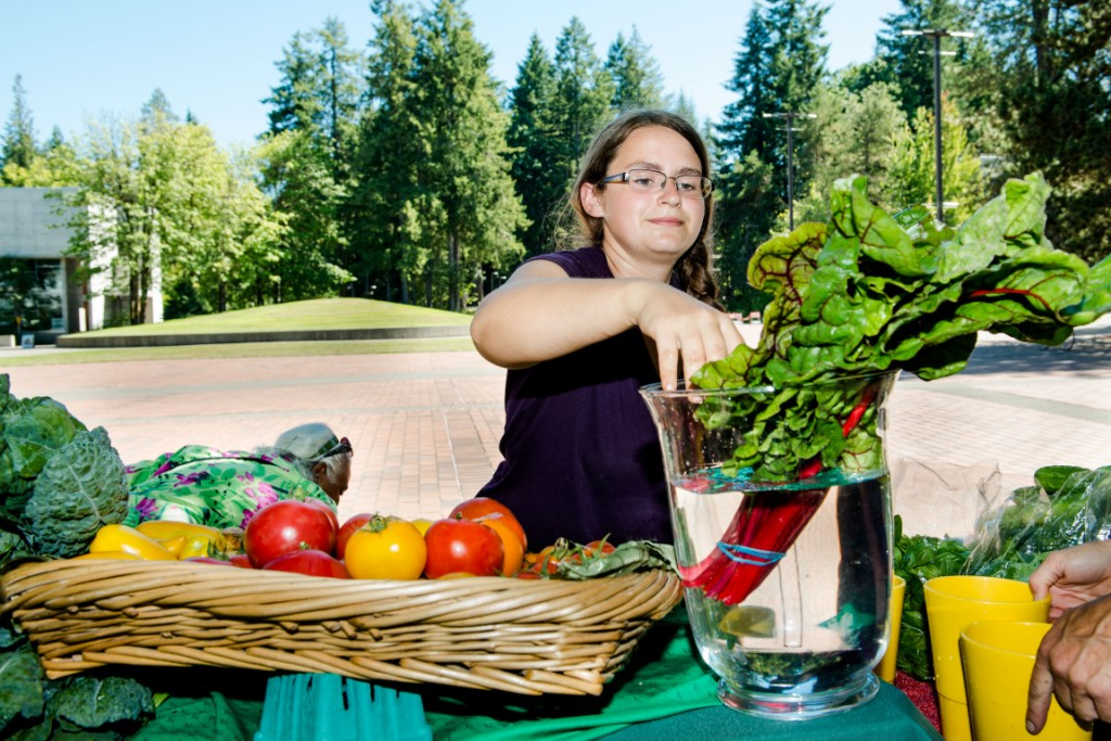 PSA students set up the farm stand to market the food grown at the Organic Farm. -- Shauna Bittle photo