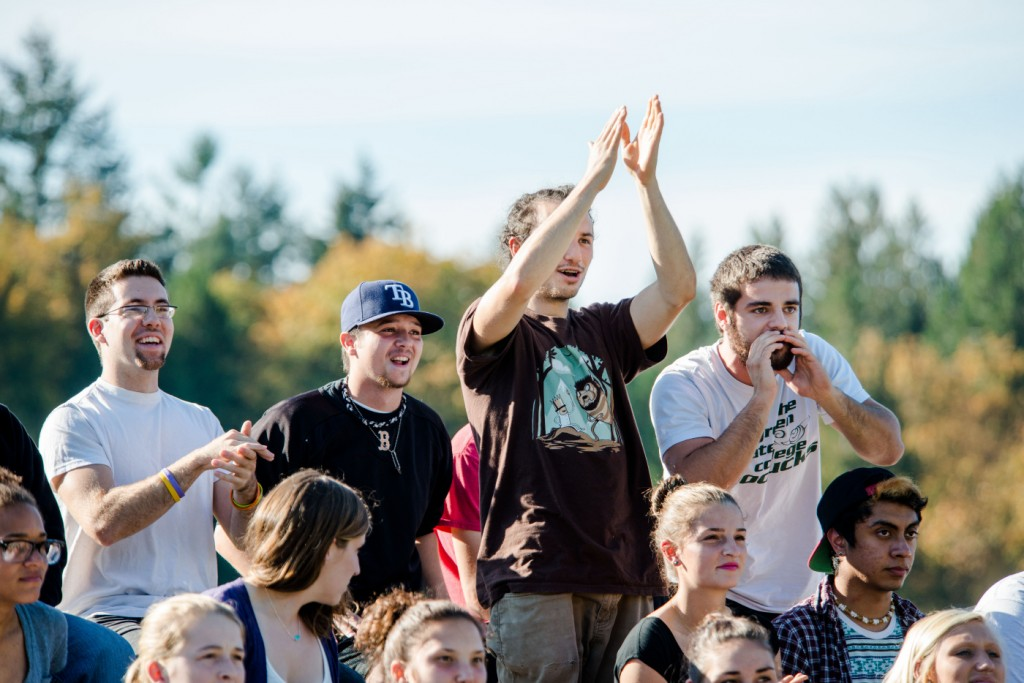 Fans cheer the men's soccer team on Tues.