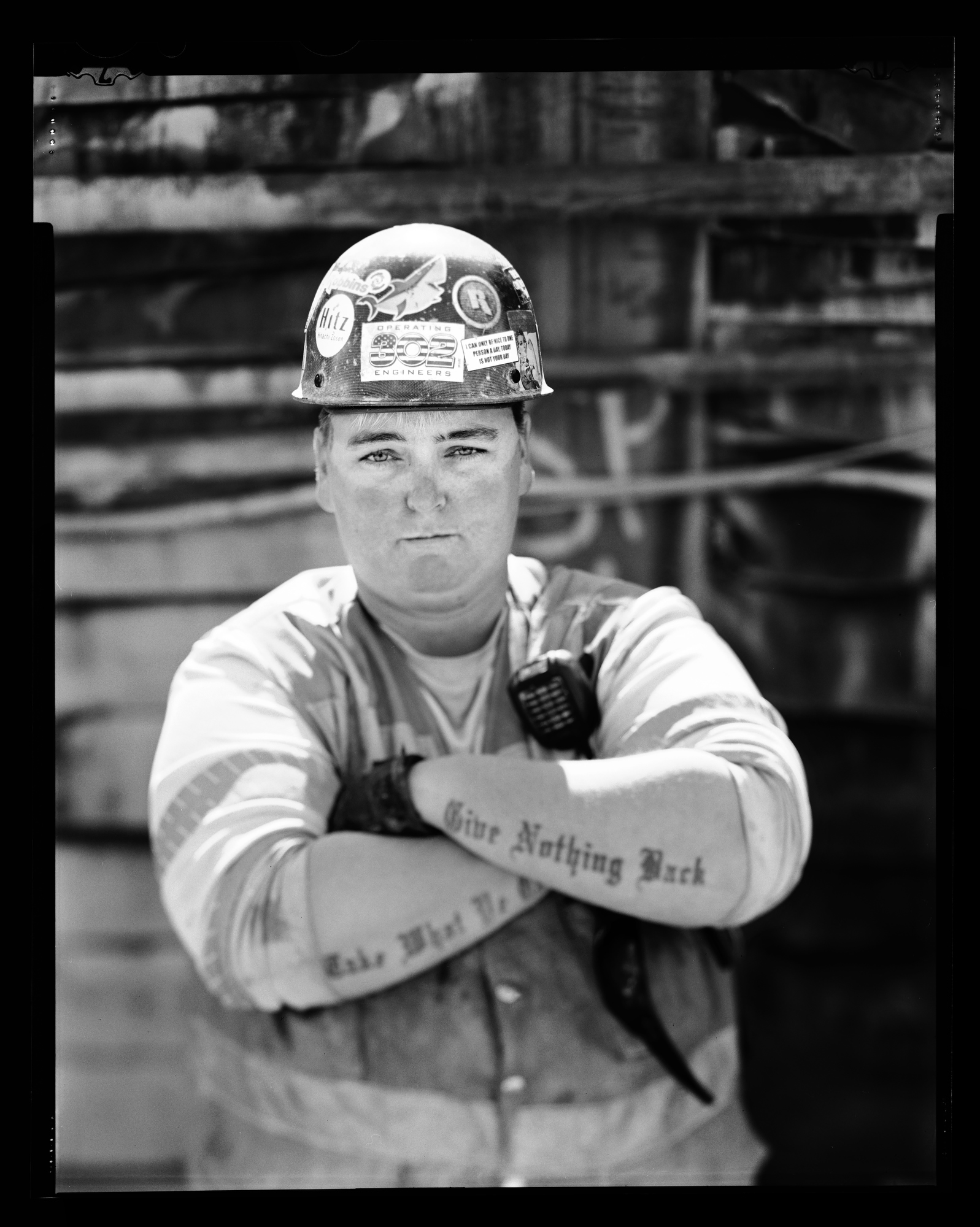 "Jamie Dicey, heavy equipment operator working on the tunnel boring project ""Brenda"" near Northgate Mall in Seattle. Photographed April 29, 2015 for the Women in the Trades portrait series on a 4x5 camera with black and white film."