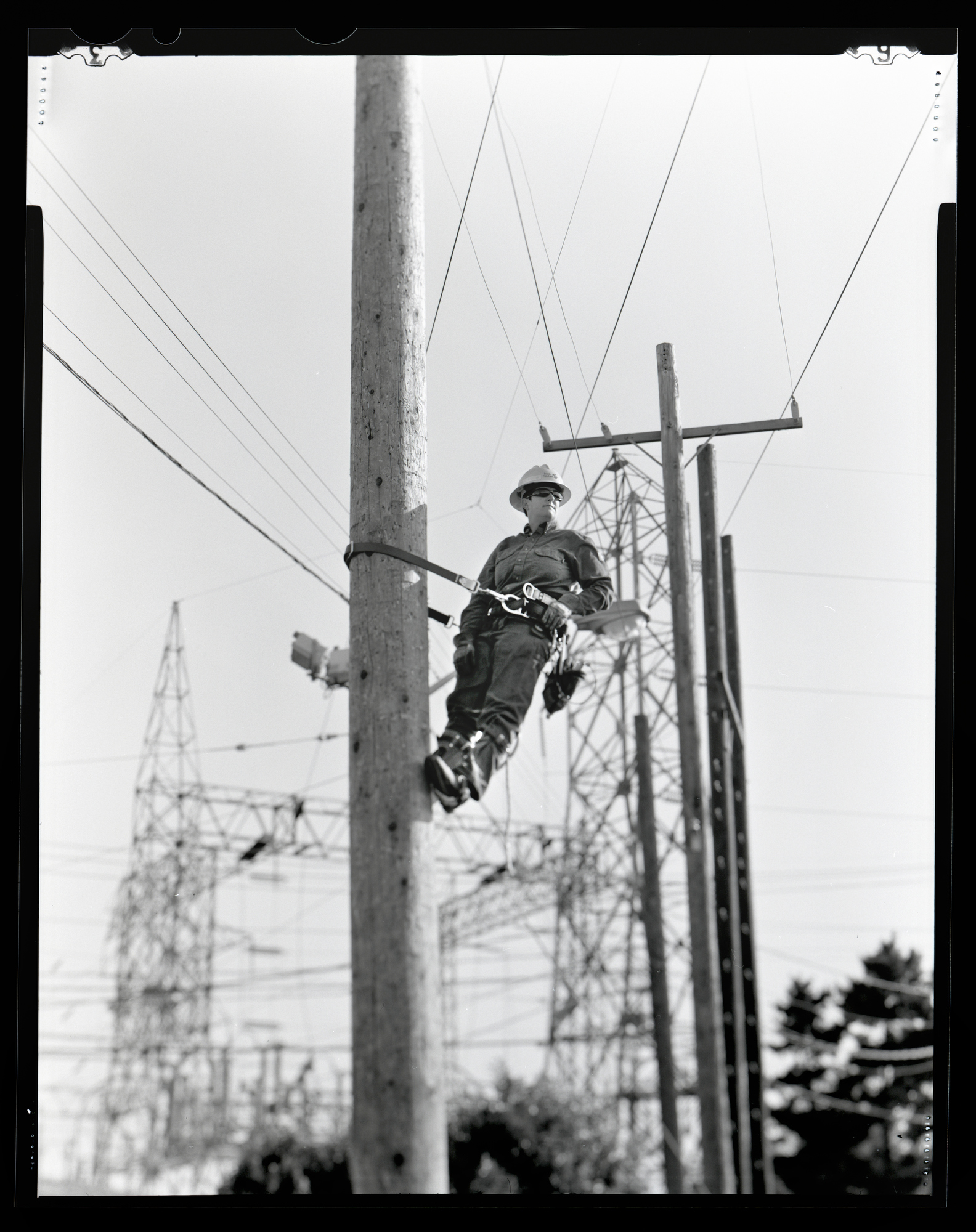 Shannon Fitch is a journeyman lineman for Seattle City Light. Photographed May 4, 2015 for the Women in the Trades portrait series on a 4x5 camera with black and white film.