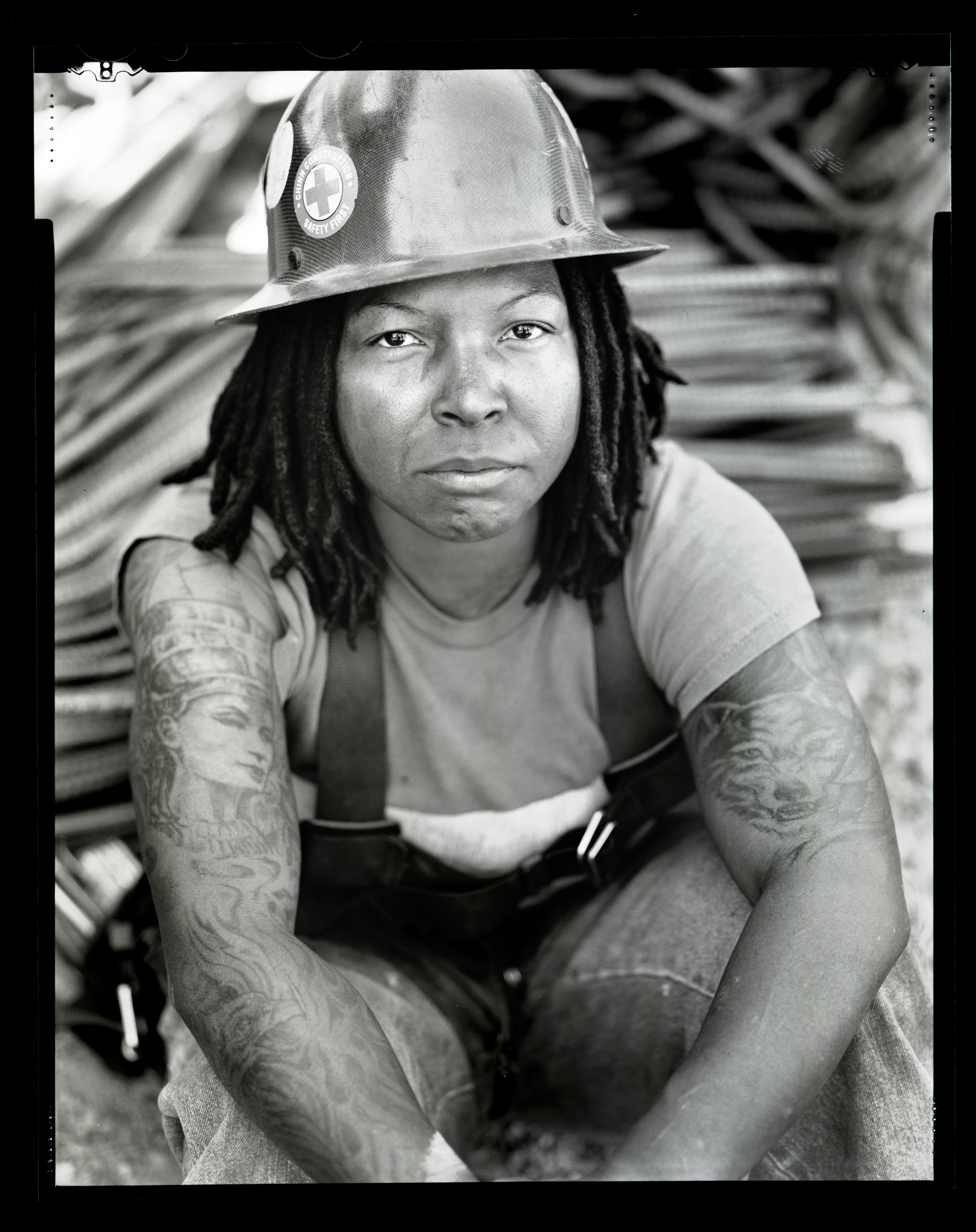 Kalena Firstrider is an ironworker.  Photographed June 23, 2015 for the Women in the Trades portrait series on a 4x5 camera with black and white film.